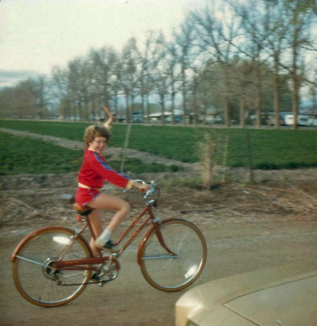 Since I could do the baling, I was most likely doing this -- riding my bike. And, take a good look at my jazzy jacket -- dang, I loved that outfit!