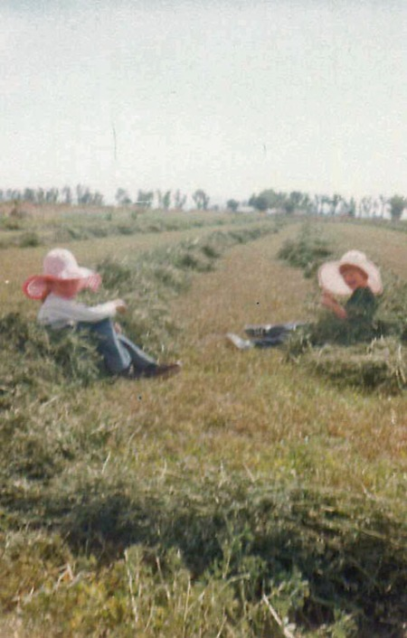 Me (in the red hat) and a friend sitting in the hay. I told you in the last blog that I really did that. DId you believe me? Look at all the rows of hay.